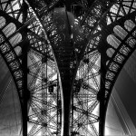 View from under the Eiffel Tower in black and white